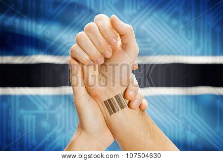 Barcode Id Number On Wrist And National Flag On Background - Botswana
