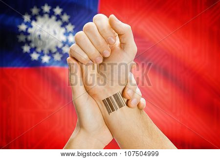 Barcode Id Number On Wrist And National Flag On Background - Burma