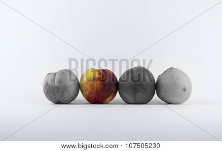 Four Peaches On A White Background