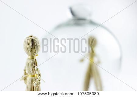Man And Woman Straw Dolls, Separated By A Glass Bell