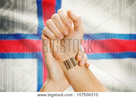 Barcode Id Number On Wrist And National Flag On Background - Faroe Islands
