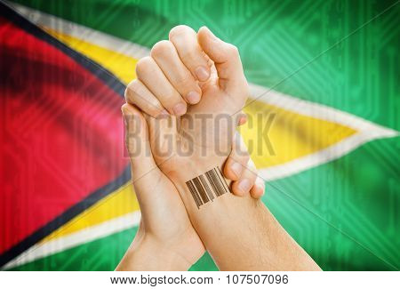 Barcode Id Number On Wrist And National Flag On Background - Guyana