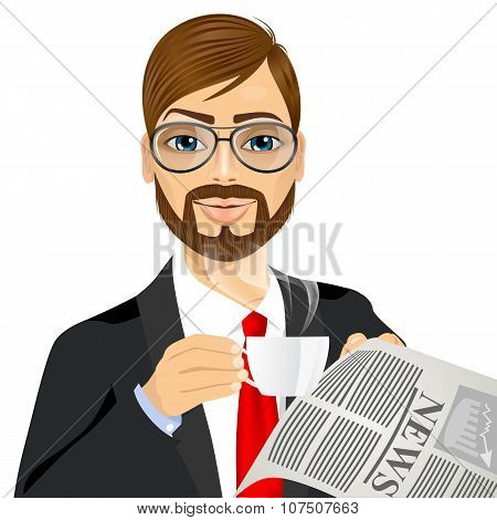 businessman drinking coffee and reading newspaper