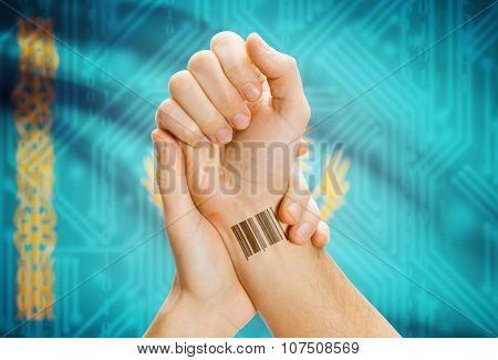 Barcode Id Number On Wrist And National Flag On Background - Kazakhstan