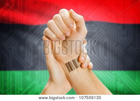 Barcode Id Number On Wrist And National Flag On Background - Libya