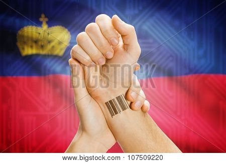 Barcode Id Number On Wrist And National Flag On Background - Liechtenstein
