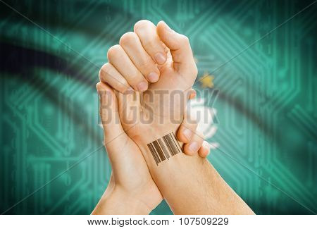 Barcode Id Number On Wrist And National Flag On Background - Macau