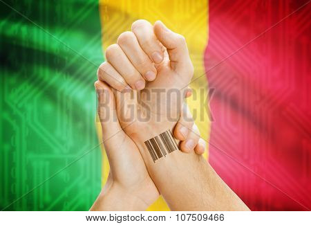 Barcode Id Number On Wrist And National Flag On Background - Mali