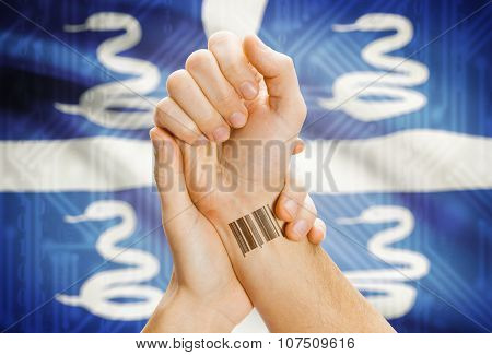 Barcode Id Number On Wrist And National Flag On Background - Martinique