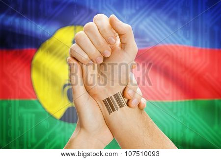 Barcode Id Number On Wrist And National Flag On Background - New Caledonia