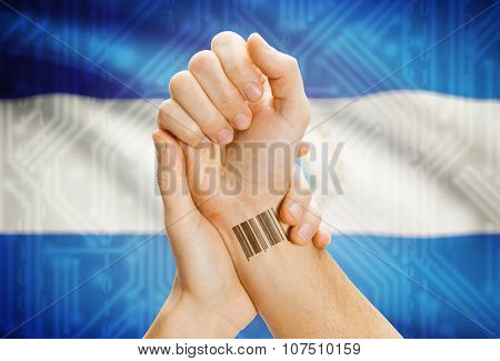 Barcode Id Number On Wrist And National Flag On Background - Nicaragua