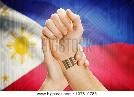 Barcode Id Number On Wrist And National Flag On Background - Philippines