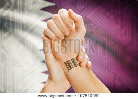 Barcode Id Number On Wrist And National Flag On Background - Qatar