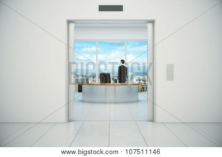 Businessman In His Office Vith City View From The Elevator Doors
