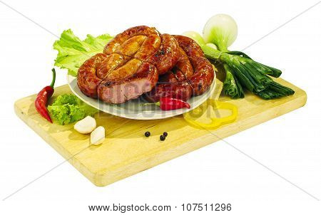 Still life - sausage on the board isolated