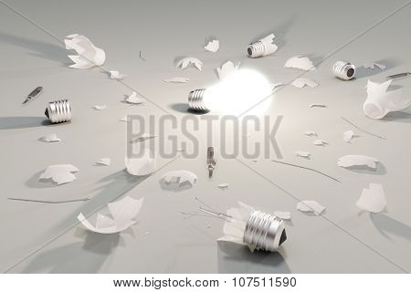 Idea Or Decision Concept With Glowing Lightbulb And Broken Lightbulbs