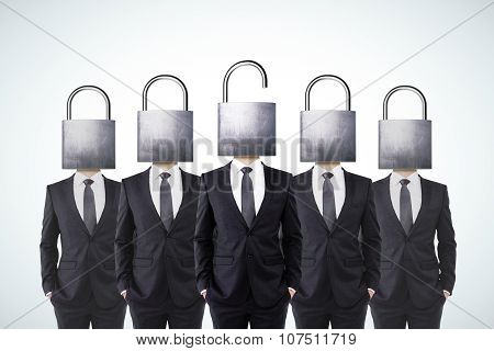 Businessmen With Closed Head Locks And Businessman With Opened Head Lock