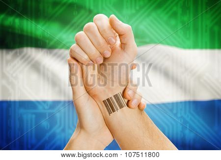 Barcode Id Number On Wrist And National Flag On Background - Sierra Leone