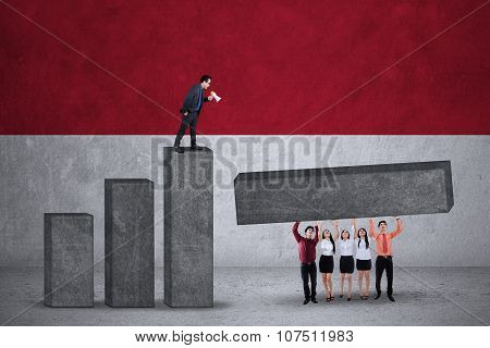 Businesspeople Make Graph With Flag Of Indonesia