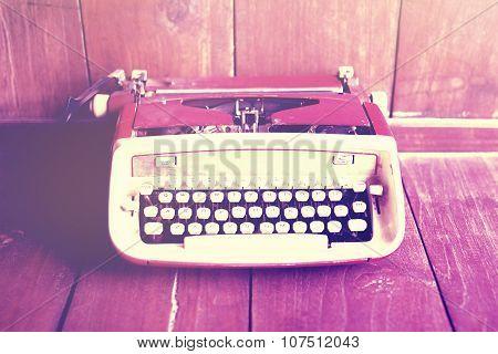 Old Style Typewriter On Wooden Floor, Instagram Photo Effect
