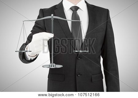 Businessman In White Gloves With Scales