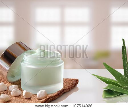 Aloe Vera Cream Jar Open On Burlap Windows Background