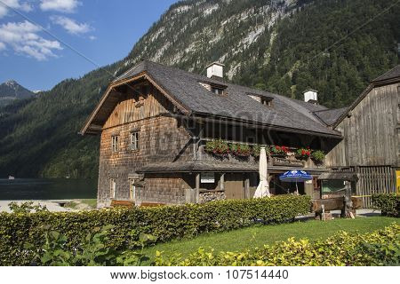 KOENIGSSEE, GERMANY - AUGUST 13, 2015: Buildings made of wood of the local fishery St. Bartholomae the fishing hut is located at the Koenigssee