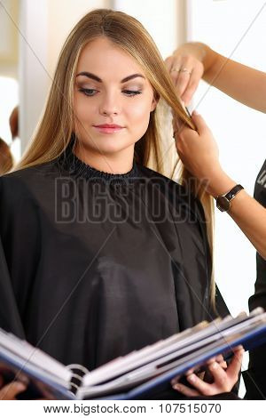 Female Hairdresser Hands Holding Comb And Scissors