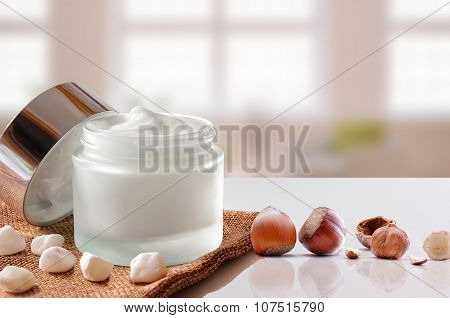 Hazelnuts Moisturizer Jar Open On Burlap Windows Background