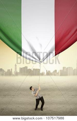 Man Drags Italian National Flag