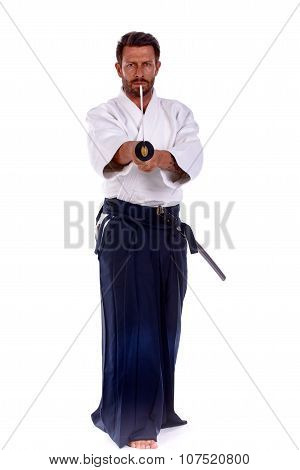 aikido master pointing thw sword