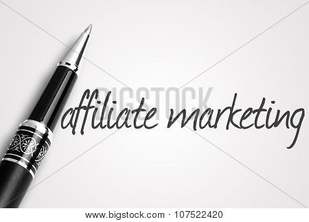 Pen Writes Affiliate Marketing On White Blank Paper