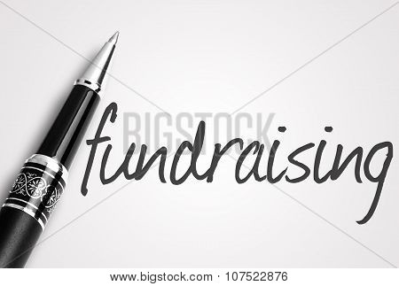 Pen Writes Fundraising  On White Blank Paper