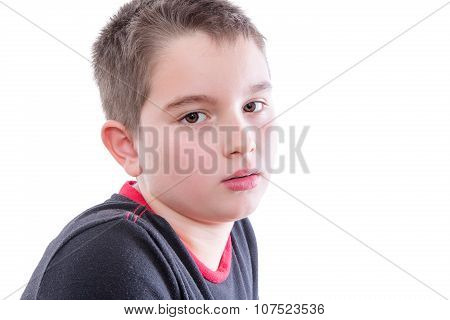 Young Serious Boy In White Studio