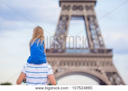 Beautiful happy family in Paris background Eiffel Tower. French summer holidays, travel and people c