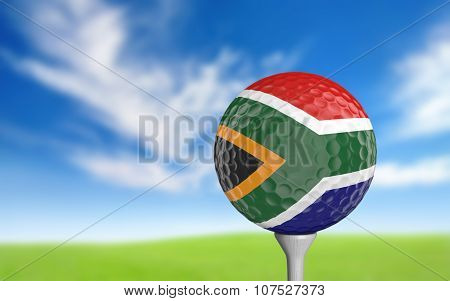 Golf ball with South Africa flag colors sitting on a tee
