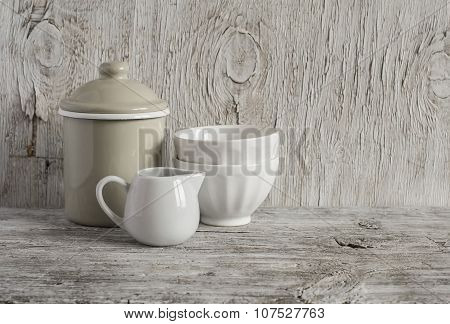 Vintage Crockery - Enamel Jug And White Ceramic Bowl On Bright Wooden Surface. Rustic Style