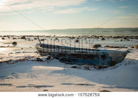 Boat Frozen In Fjord In Winter Sunshine