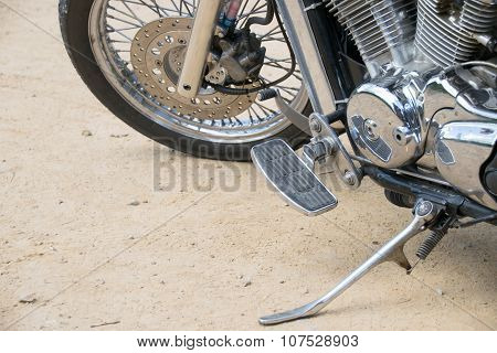 Close up Wheel and Stand motorcycle chopper on the floor.