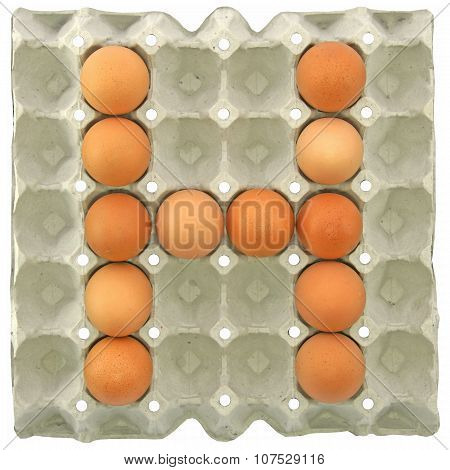 A Letter H From The Eggs In Paper Tray