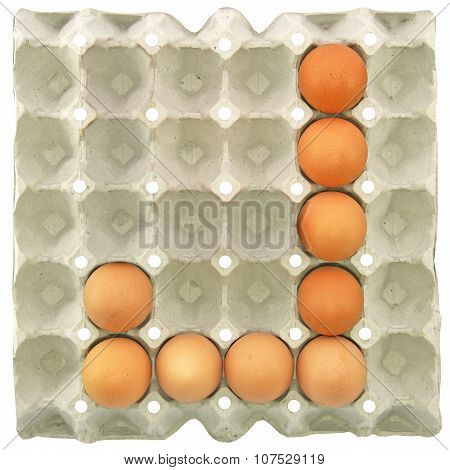 A Letter J From The Eggs In Paper Tray