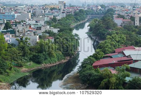 A polluted river flowing through civilian area