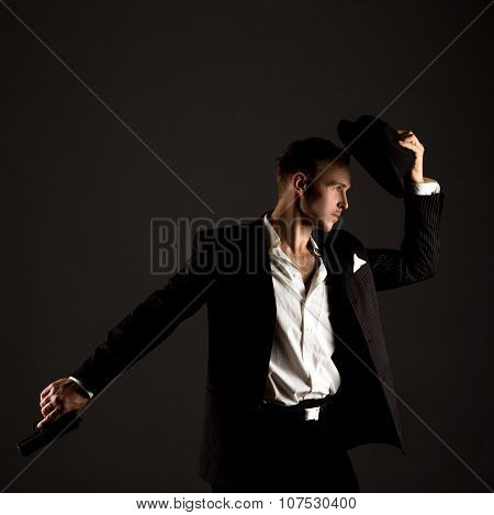 Handsome male dancer posing in gangster suit