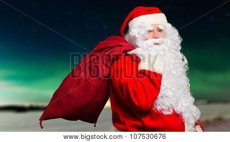 Santa Claus holding his sack outdoor