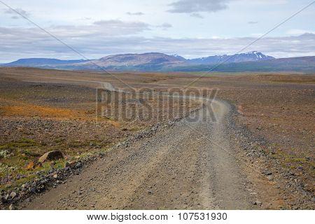Scenic one lane gravel road in Iceland