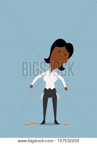 Sad businesswoman with empty pockets