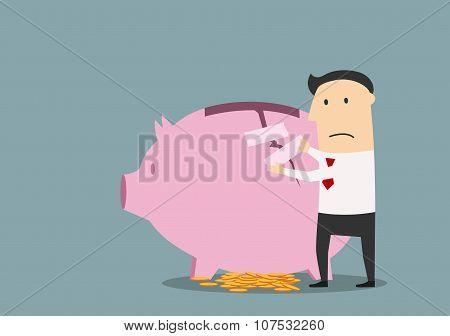 Businessman repairing cracked piggy bank