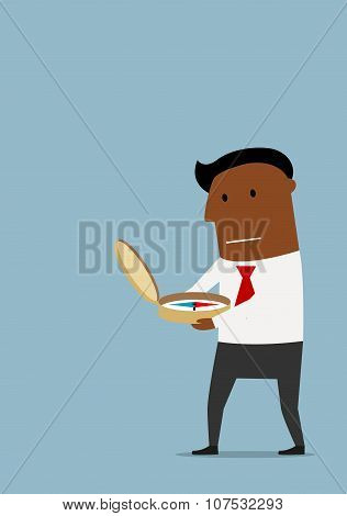 Cartoon businessman with compass in hands