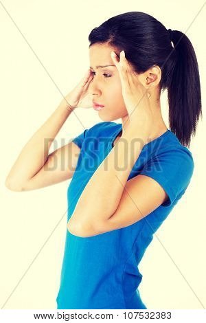Woman with headache or problem holding her hand to the head