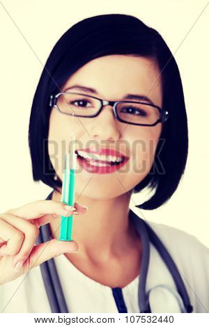 Happy medical doctor or nurse with syringe.
